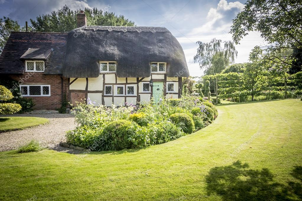 depositphotos_83221442-stock-photo-english-village-thatched-cottage-and